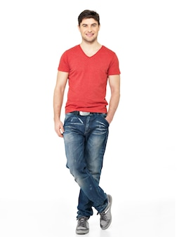 Full portrait of smiling happy handsome man in red t-shirt casuals  isolated on white background. beautiful young guy posing