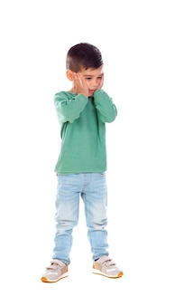 Full portrait of surprised child with jeans and green t-shirt
