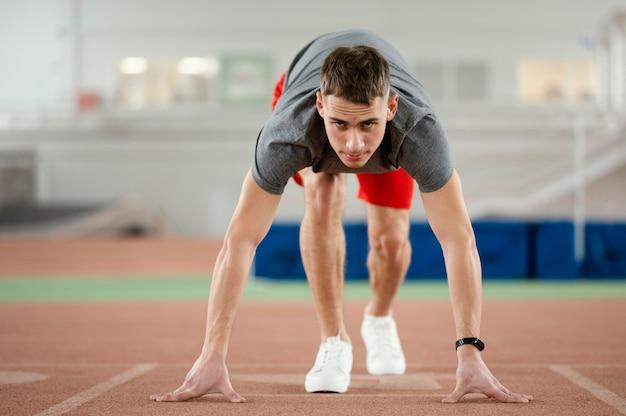 Full shot athlete ready to run