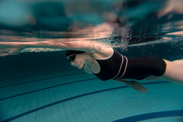 Full shot athlete swimming