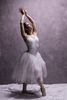 Full shot ballerina posing gracefully