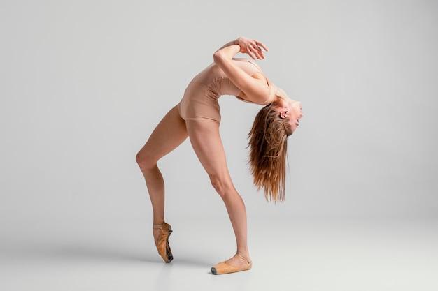 Full shot ballerina posing