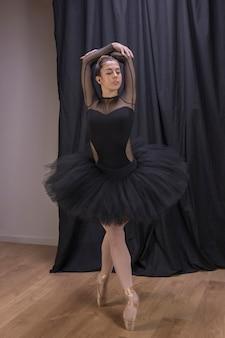 Full shot ballet position indoors