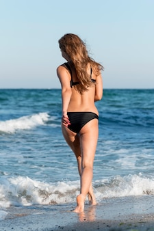 Full shot of beautiful girl at beach