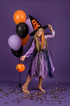 Full shot of beautiful girl with witch costume