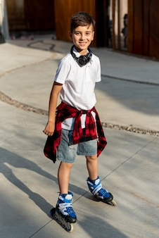 Full shot of boy with blue roller blades