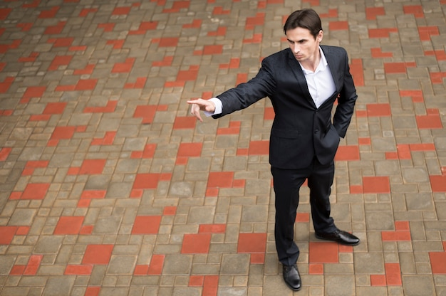 Full shot of businessman pointing