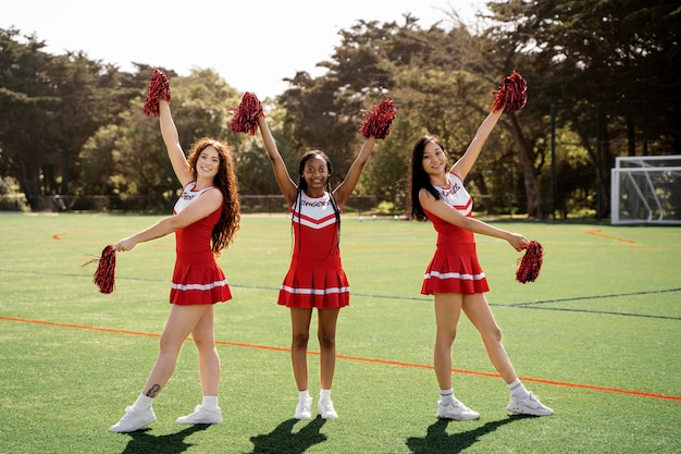 Full shot cheerleaders on field