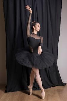 Full shot classic ballet posture