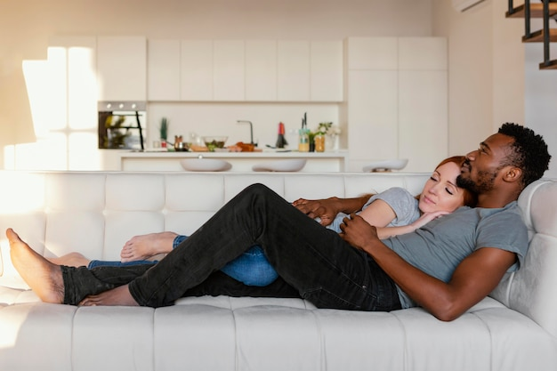 Full shot couple on couch