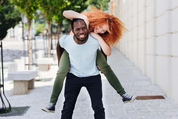 Full shot of couple having fun