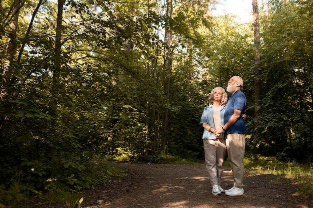 Full shot couple holding hands