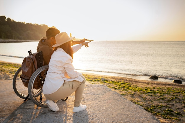 Full shot couple looking at sea