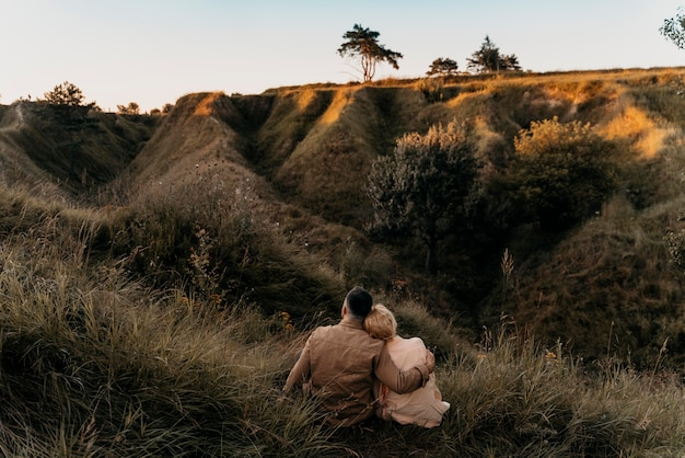 Full shot couple in nature