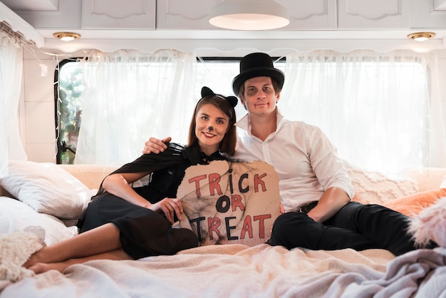 Full shot couple sitting in bed