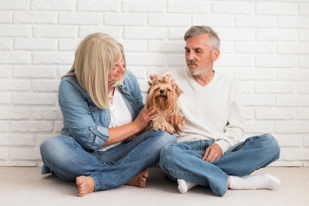 Full shot couple with cute dog