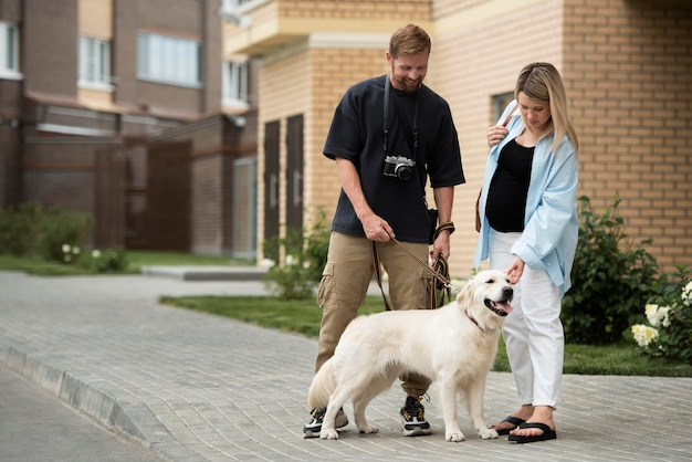 Full shot couple with dog