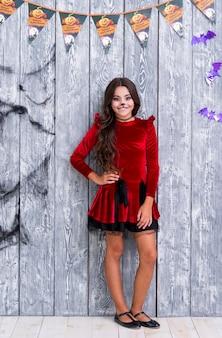 Full shot cute girl posing for halloween