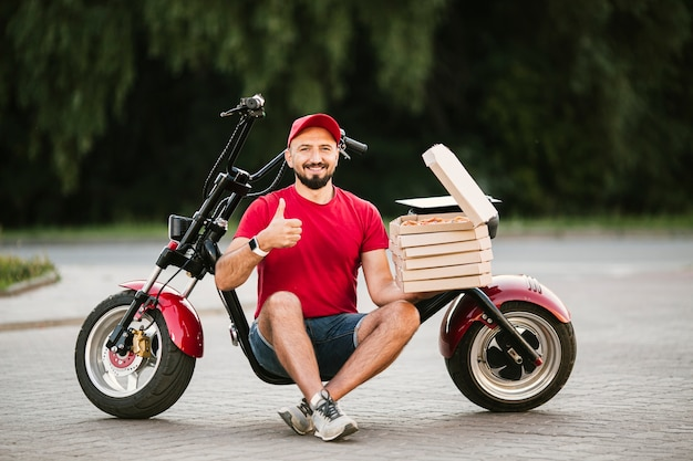 Full shot delivery guy showing approval