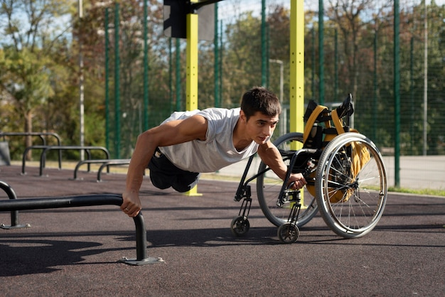 Full shot disabled man doing push-ups