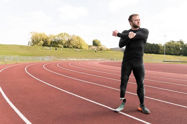 Full shot disabled man stretching