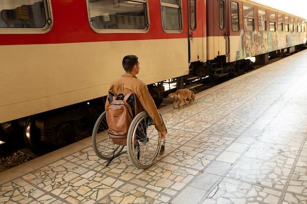 Full shot disabled man at train station