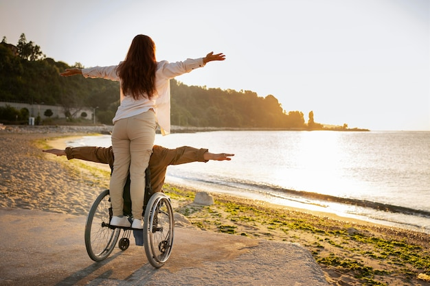 Full shot disabled man and woman in vacation