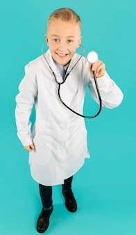 Full shot of doctor holding stethoscope