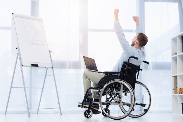 Full shot excited man in wheelchair