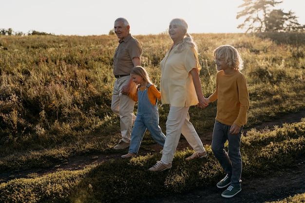 Full shot family members holding hands