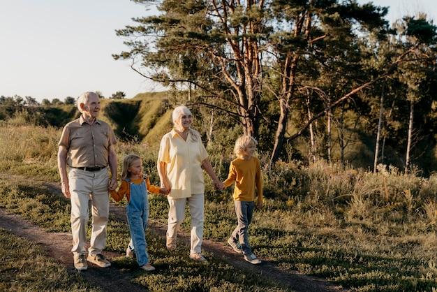 Full shot family members walking together