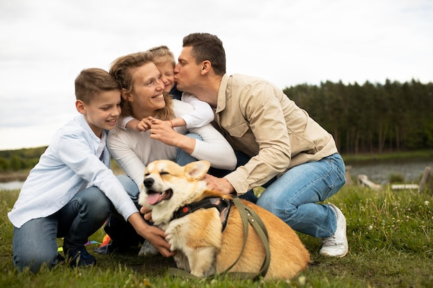 Full shot family with cute dog