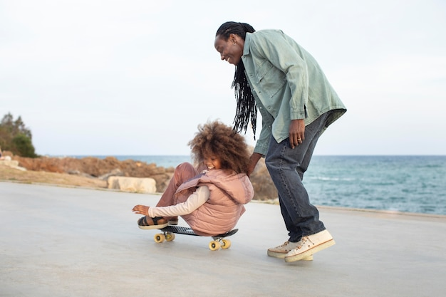 Full shot father and girl with penny board