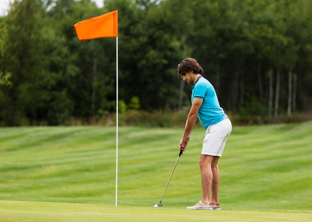 Full shot fit active golfer exercising