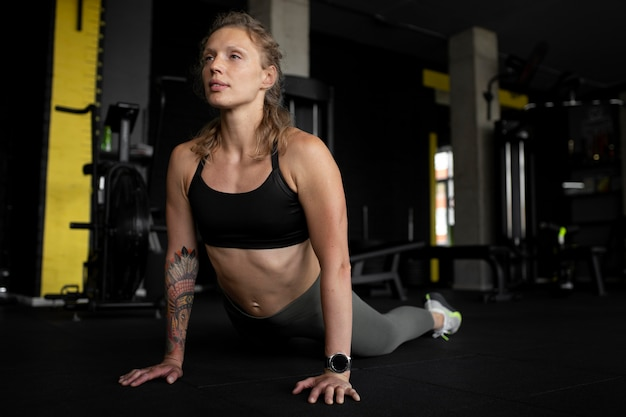 Full shot fit woman training at gym