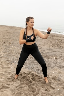 Full shot fit young girl training outdoor