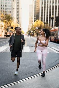 Full shot friends jogging together