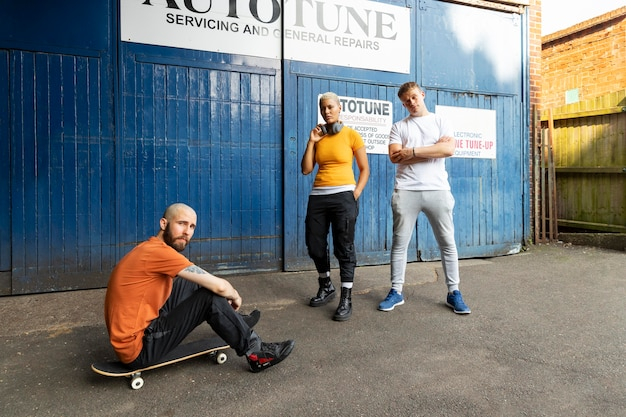 Full shot friends with skateboard
