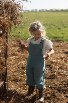 Full shot girl at farm