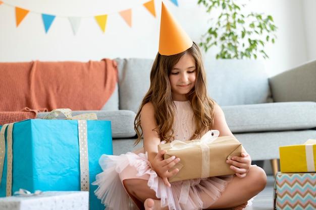 Full shot girl holding gift