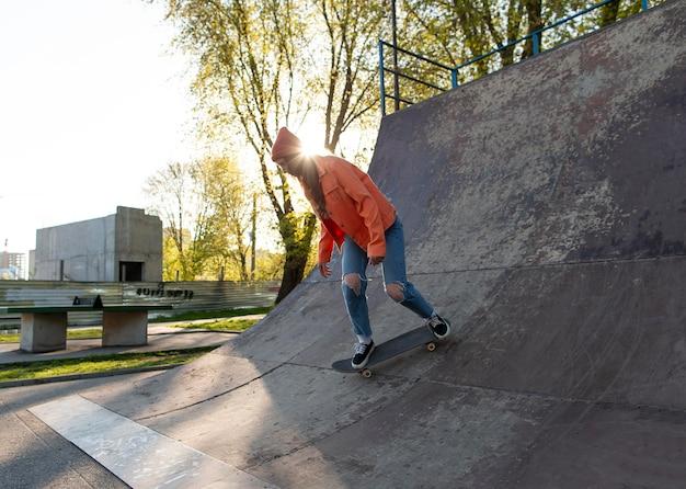 Full shot girl skating on ramp