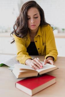 Full shot girl studying indoors