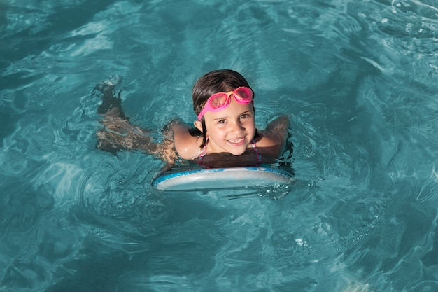 Full shot girl swimming with goggles