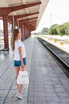 Full shot girl in train station
