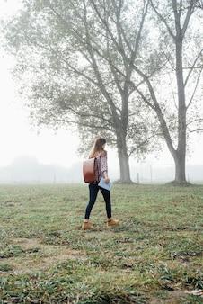 Full shot girl walking through nature