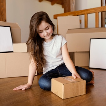 Full shot girl with box