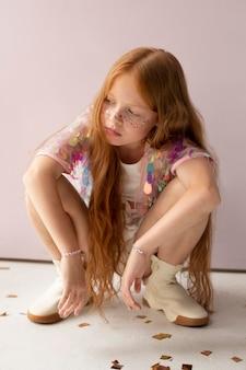 Full shot girl with ginger hair pose