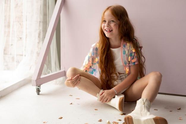 Full shot girl with ginger hair posing