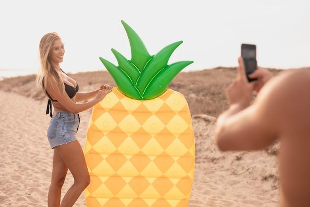 Full shot of girlfriend posing for photo