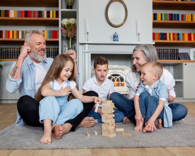 Full shot happy family on carpet
